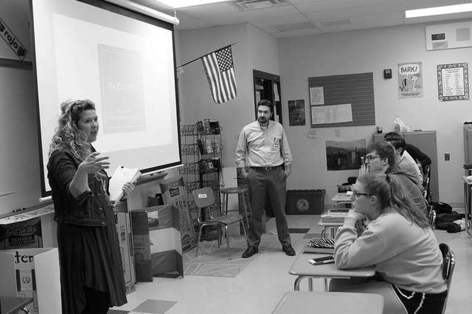 SIUE graduate students and Madison Historical research assistants Lesley Thomson and Brendon Floyd lead a history lesson at Bethalto's Civic Memorial High School. Photo:       For The Telegraph