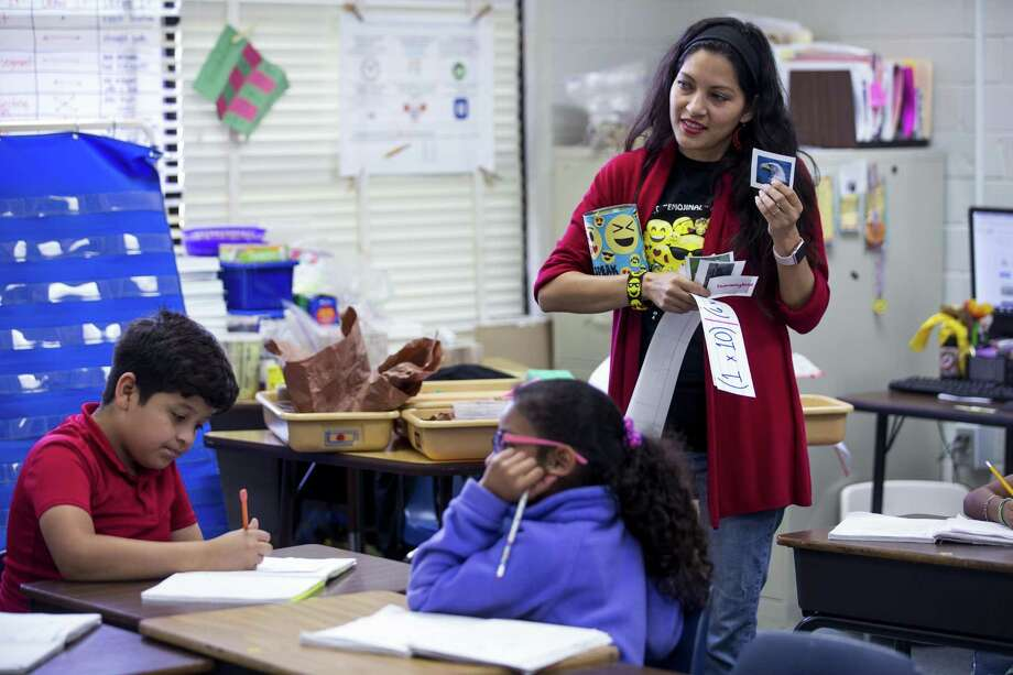 Fourth grade teacher Gabriella Bogani works with her class at Jackson Elementary School in Rosenberg. The Lamar CISD school jumped from 405th to 148th in the annual rankings. Photo: Brett Coomer, Staff / Houston Chronicle / © 2018 Houston Chronicle