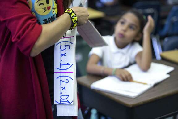 Fourth grade teacher Gabriella Bogani works with her class at Jackson Elementary School in Rosenberg. The Lamar CISD school jumped from 405th to 148th in the annual rankings.