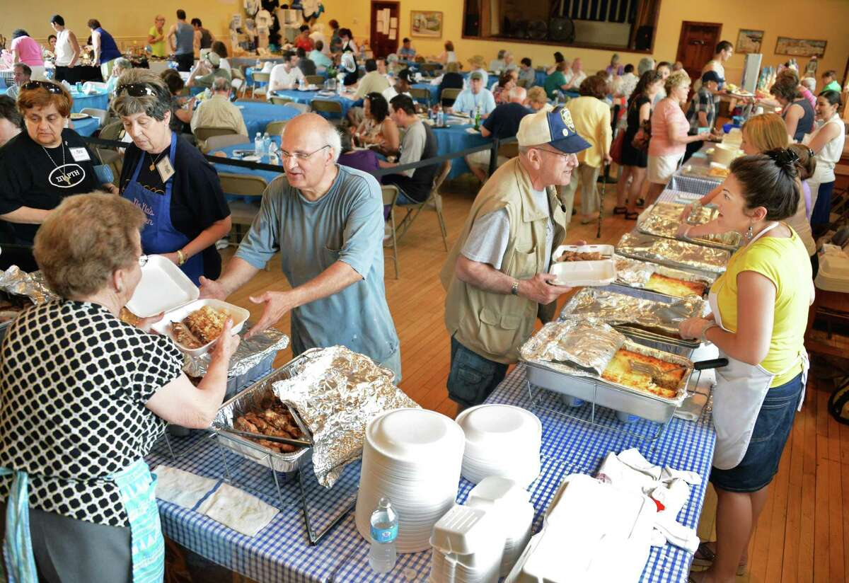 Tradition Greek fare is srved up at the annual Greek Festival at St. Basil's Greek Orthodox Church on River Street in Troy, NY, Saturday June 1, 2013. The festival continues on Sunday. (John Carl D'Annibale / Times Union)