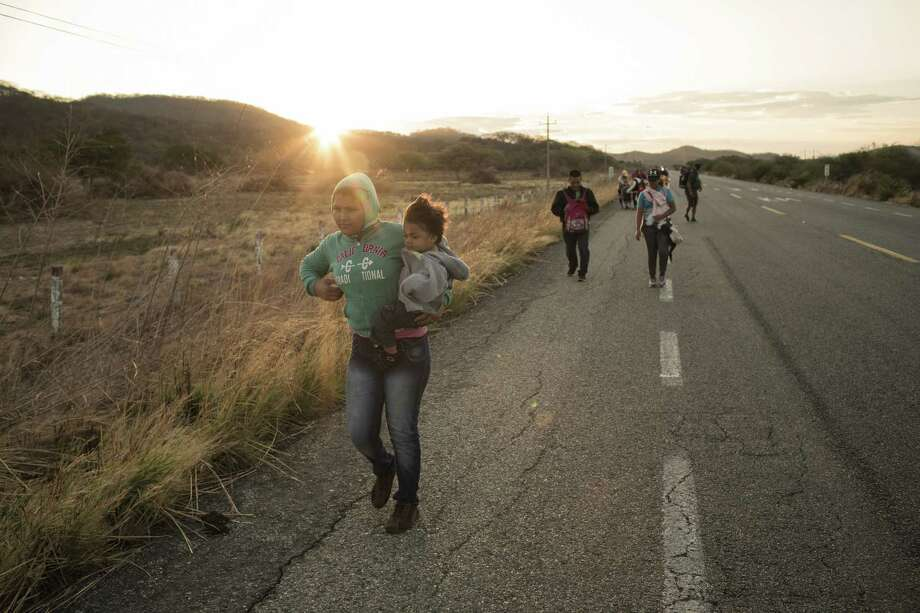 Central American refugees and asylum seekers, led by the humanitarian organization People Without Borders, walk in the town of Santiago Niltepec, Oaxaca state, Mexico, on March 31. Photo: Bloomberg Photo By Jordi Ruiz Cirera / © 2018 Bloomberg Finance LP