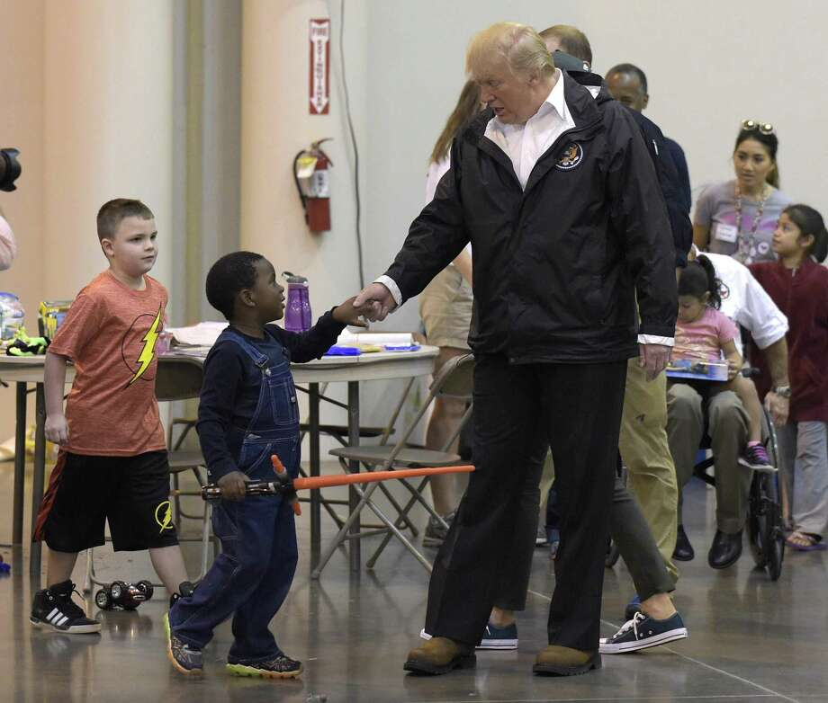 President Donald Trump meets people impacted by Hurricane Harvey during a visit to the NRG Center in Houston, Saturday, Sept. 2, 2017. It was his second trip to Texas in a week, and this time his first order of business was to meet with those affected by the record-setting rainfall and flooding. He's also set to survey some of the damage and head to Lake Charles, Louisiana, another hard-hit area.   (AP Photo/Susan Walsh) Photo: Susan Walsh, STF / Associated Press / Internal