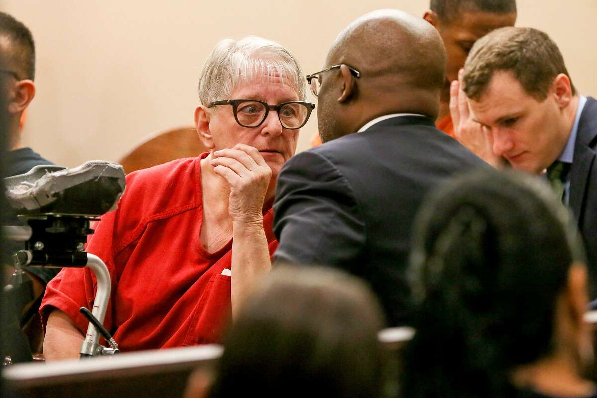 Convicted child killer Genene Jones talks with defense attorney Cornelius Cox on May 20, 2018, after Criminal Magistrate Judge Andrew Carruthers approved Cox's request for competency and sanity evaluations during a hearing in his court. Jones has been charged with five new counts of murder in the deaths of five San Antonio children.