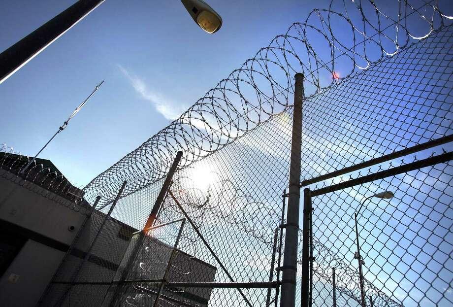 Razor wire on the fencing at the Polunsky Unit in Livingston, TX. Thursday, Jan. 5, 2012. Photo Bob Owen/rowen@express-news.net Photo: BOB OWEN, STAFF / SAN ANTONIO EXPRESS-NEWS / rowen@express-news.net