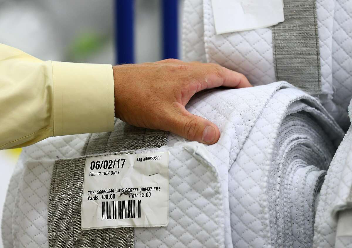 Jeff Collier, Operations Manager Serta Simmons Bedding Houston, talks about materials used for the sides of mattresses during a tour of the new 265,000 square feet factory Thursday, Oct. 5, 2017, in Houston. ( Godofredo A. Vasquez / Houston Chronicle )