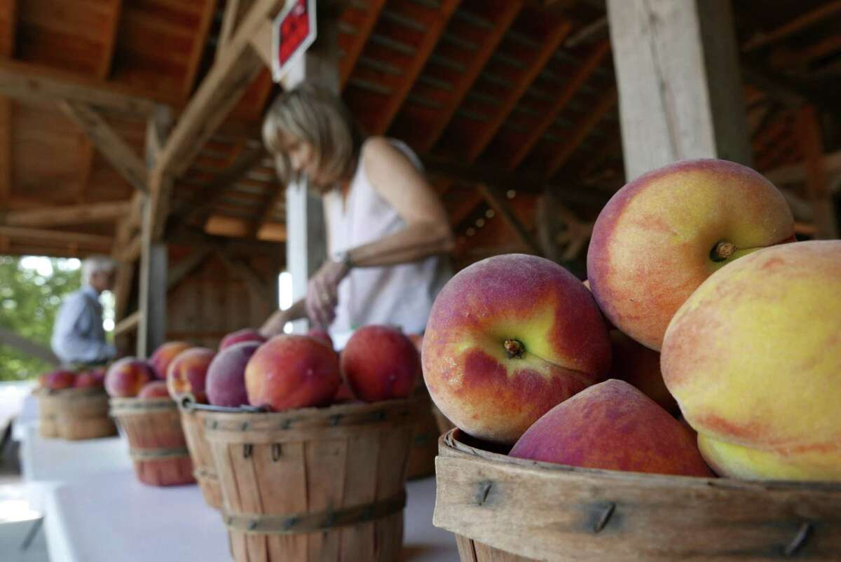 Baskets of fresh peaches are ready for buyers at a fruit stand run by Russ and Lori Studebaker near Fredericksburg.