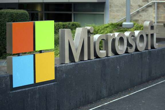 Signage is displayed outside the Microsoft Corp. main campus in Redmond, Washington.