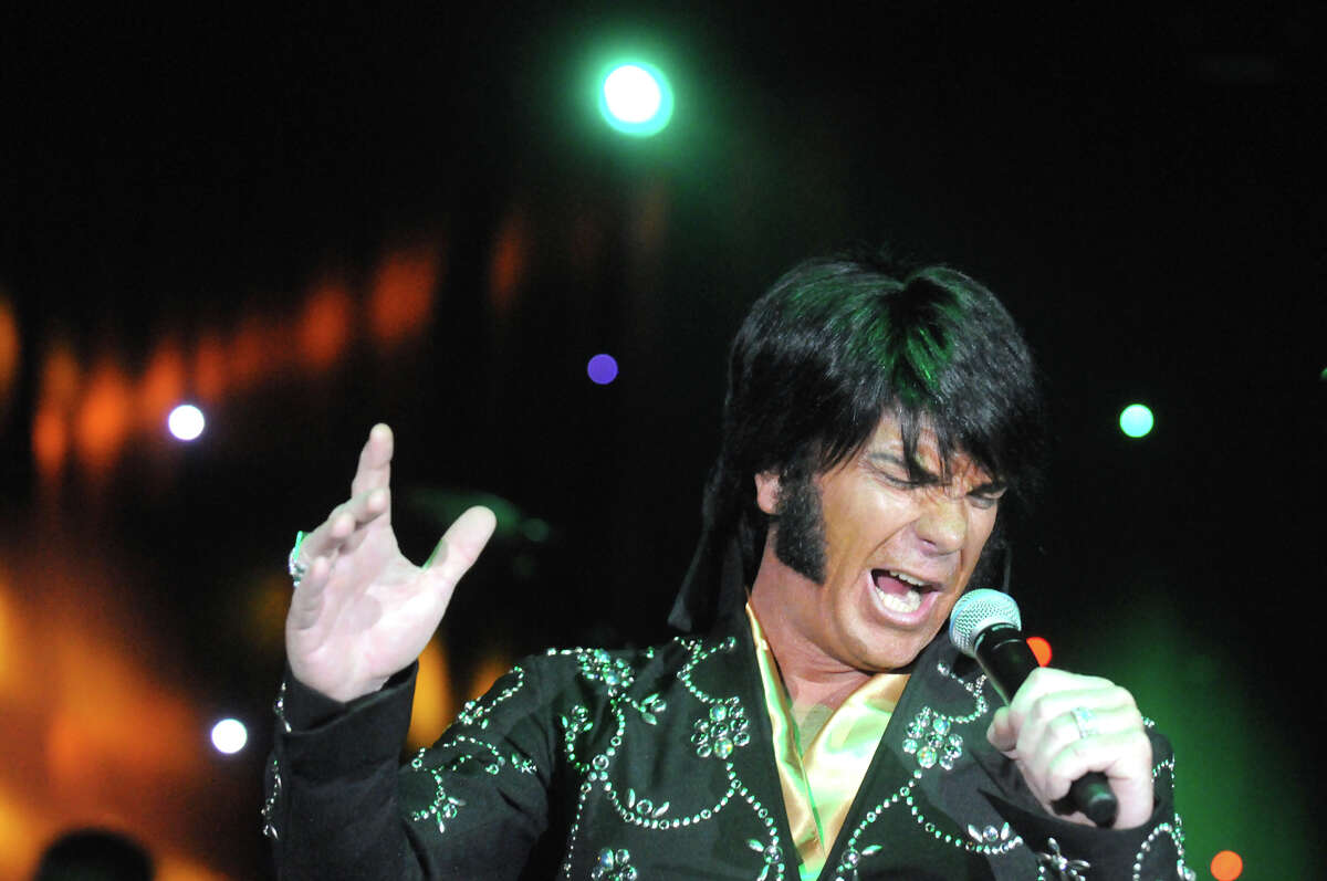 Brad Mitchell from Wasington state performs in the first round of the Elvis tribute artist competition at Lake George Forum as part of Elvis Festival on Friday May 29, 2015 in Lake George, N.Y. (Michael P. Farrell/Times Union)