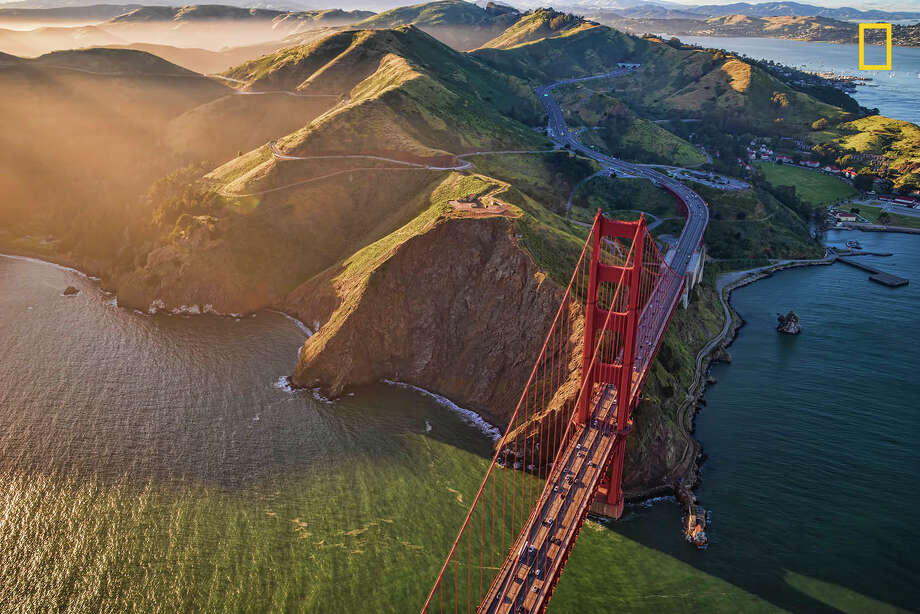 """An aerial view of the Golden Gate Bridge in the late afternoon with the Marin headlands in the background.""