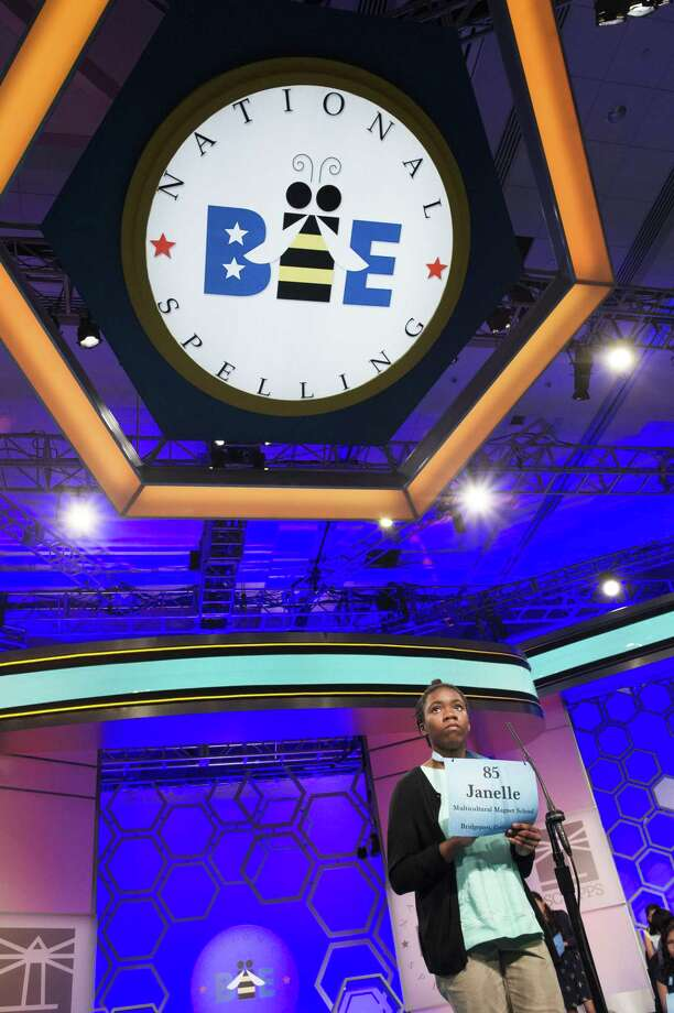 Janelle Newell, 11, from Bridgeport, Conn., spells her word during the 3rd Round of the Scripps National Spelling Bee in Oxon Hill, Md., Wednesday, May 30, 2018. (AP Photo/Cliff Owen) Photo: Cliff Owen / Associated Press / FR170079 AP
