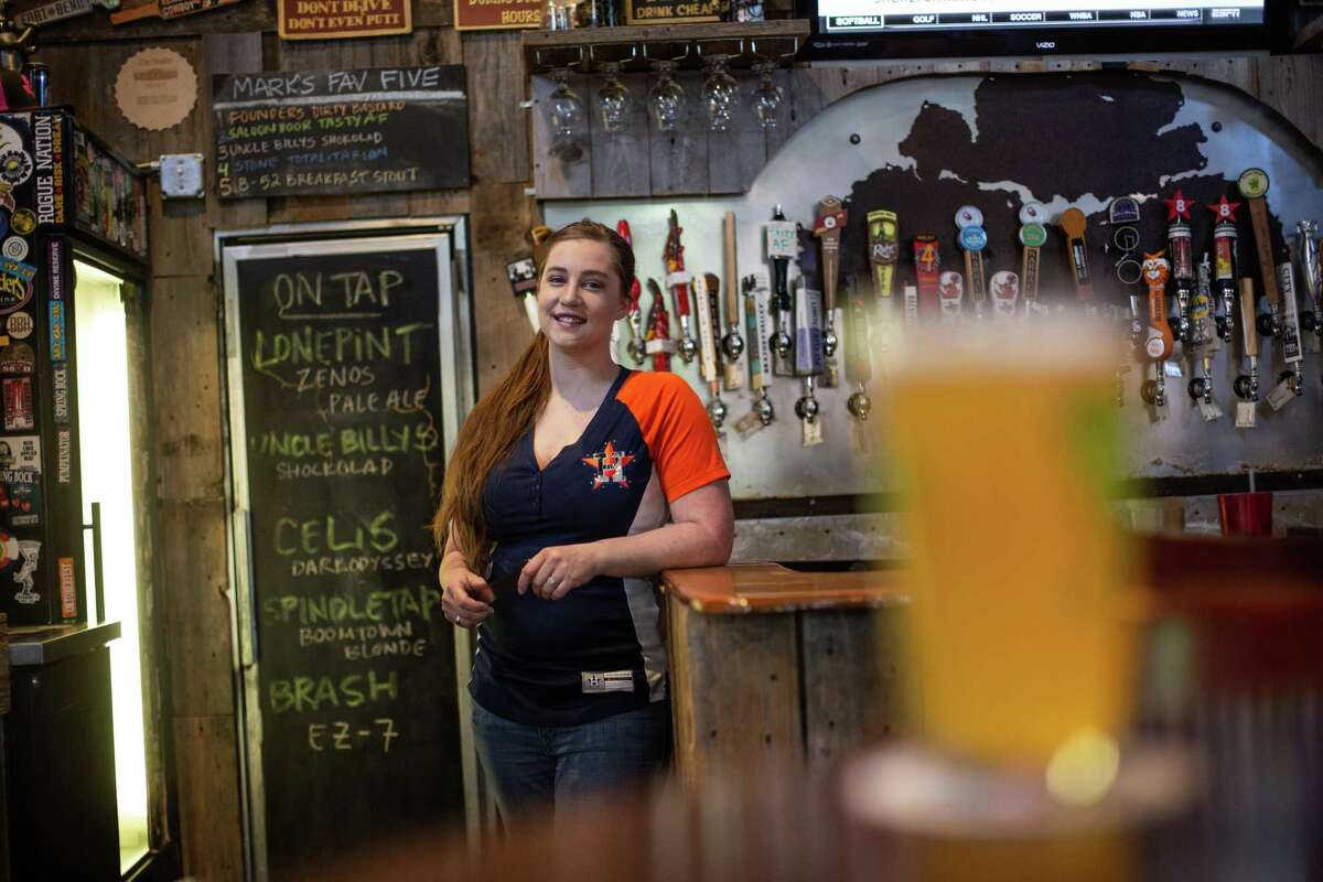 Bartender Jaclyn Campbell poses for a portrait at the bar at The Backyard Grill.