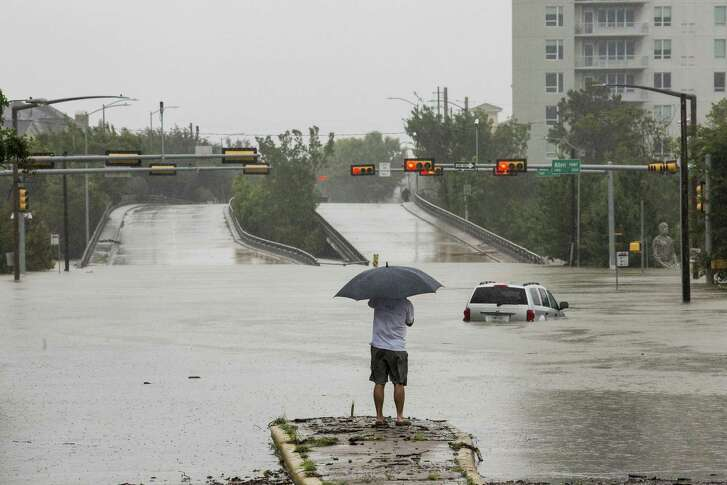FILE -- A flooded car near downtown Houston, on Aug. 28, 2017, in the aftermath of Hurricane Harvey. Houston and Harris County officials are holding a series of public meetings to get input on how they should spend about $1 billion that each received for long-term Harvey recovery