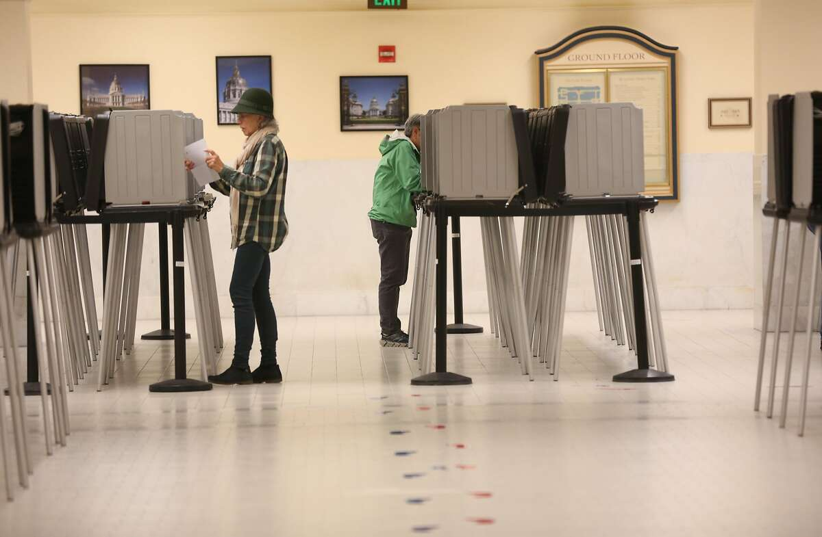 Voters during lunch at the city hall voting center on Thursday, May 24, 2018 in San Francisco, Calif. Looking how ranked-choice voting will have an effect in this year's election.