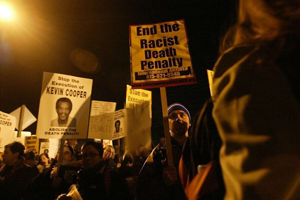 Protesters opposed to the execution of Kevin Cooper in Larkspur in 2004. Thanks to media attention and a new statement by U.S. Senator Kamala Harris, there is new pressure on Gov. Jerry Brown to allow a new DNA test in the Kevin Cooper case. Cooper was convicted of four counts of first degree murder in 1983, in a case that judges and some of the original jurors have questioned.