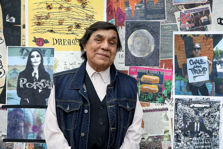 Artist René Yañez, who popularized Dia de los Muertos and Frida Kahlo in San Francisco, pastes his art on a wall fronting the jail cells of the former Mission Police Station in December. Photo: Liz Hafalia / The Chronicle 2017