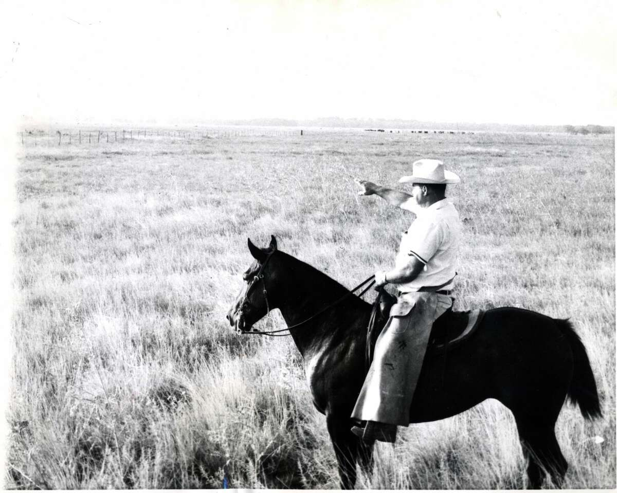 1961: Looking like a well fed Texas Cowboy, H.H. Smith points out the site of the space laboratory to be built 22 miles form downtown Houston. It will be America's largest space lab. Smith is manager of the Clear Lake ranch, owned by the oil company (Humble) which gave the 1,000 acre site to Rice University on condition it be used for a space center. Rice will lease the land to the National Aeronautics and Space Administration (NASA).