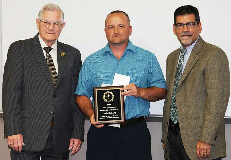 Water/Sewer Superintendent Daniel Roberts has been named the 2018 City of Conroe Employee of the Year. Pictured with Roberts is Mayor Toby Powell (left) and City Administrator Paul Virgadamo (right). Photo: Courtesy