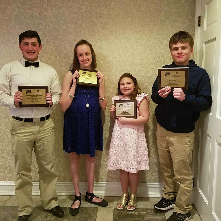 Lewis S. Mills High School's Cameron Baiardi and Regan Mills and Har-Bur Middle School's Avery Rhinesmith and Nathan Wilmarth were recently honored with the CIAC Mike Savage Exemplary Unified Teammate award at the 15th Annual Michaels Unified Sports Cup Awards. Baiardi and Mills were honored in the high school division, Rhinesmith and Wilmarth received the award for the middle school division. From left are Cameron Baiardi, Regan Mills, Avery Rhinesmith and Nathan Wilmarth. Photo: Contributed Photo