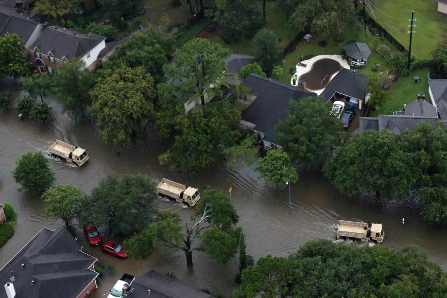 Rescue vehicles drive through a neighborhood off Cypress Creek as floodwaters rise from Tropical Storm Harvey on Tuesday, Aug. 29, 2017, in Houston. ( Brett Coomer / Houston Chronicle ) Photo: Brett Coomer, Staff / Houston Chronicle / © 2017 Houston Chronicle