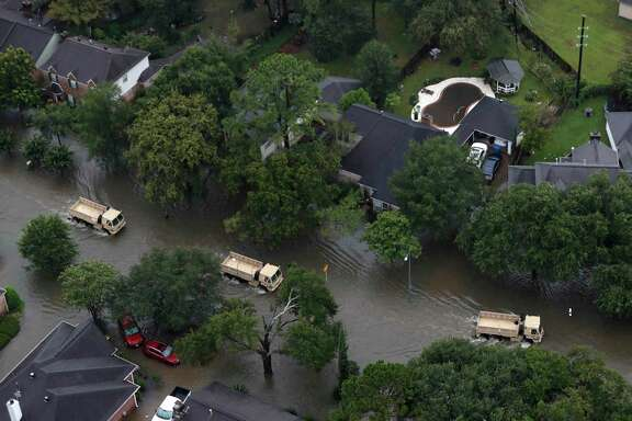 Rescue vehicles drive through a neighborhood off Cypress Creek as floodwaters rise from Hurricane Harvey on Tuesday, Aug. 29, 2017, in Houston. ( Brett Coomer / Houston Chronicle )