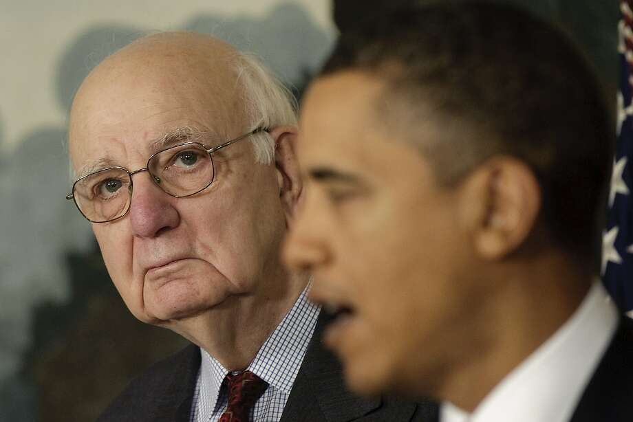 Former Federal Reserve chief Paul Volcker (left) listens as President Barack Obama talks of financial reform at the White House in 2010. Now the Federal Reserve may overturn some of those reforms. Photo: Jim Watson / AFP / Getty Images 2010