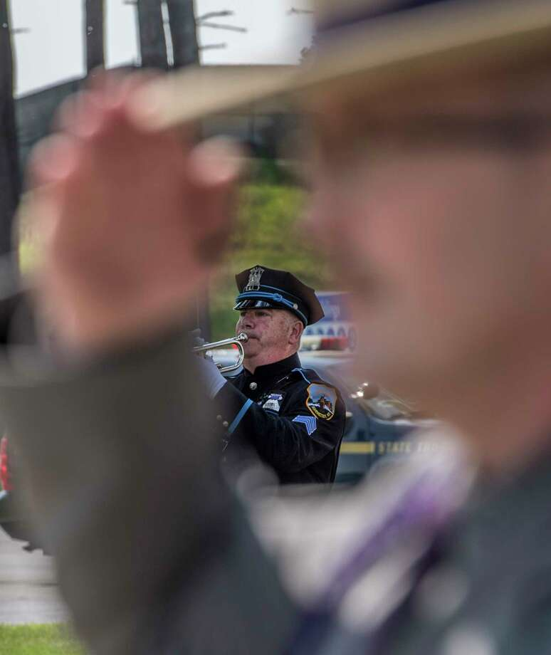 Sean Solomon of the Schenectady Police Honor Guard play Taps at the Annual Memorial and Awards Ceremony held at the training academy Wednesday May 30, 2018 in Albany, N.Y.  (Skip Dickstein/Times Union) Photo: SKIP DICKSTEIN, Albany Times Union / 40043944A