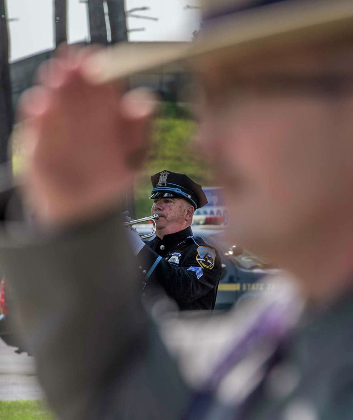 Sean Solomon of the Schenectady Police Honor Guard play Taps at the Annual Memorial and Awards Ceremony held at the training academy Wednesday May 30, 2018 in Albany, N.Y. (Skip Dickstein/Times Union)
