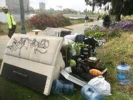 City prepares to discard homeless belongings on edge of Lake Merritt 9n Wednesday,� as part of a clean up in advance of Oakland hosting the NBA finals.