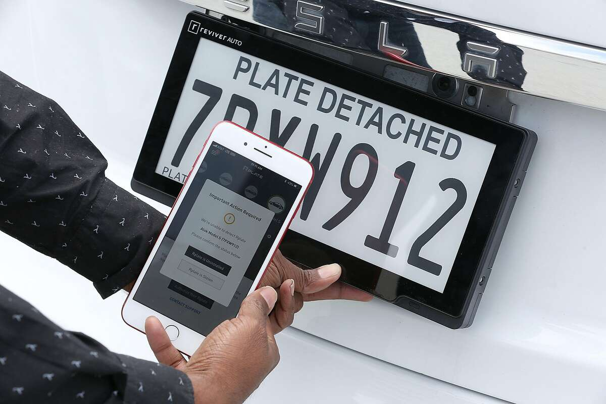 VP of engineering Alok Damireddy shows how his app alerts him through his app when his license plate from Reviver is detached on Wednesday, May 30, 2018 in Foster City, Calif.