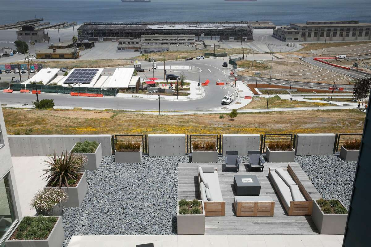 A common outdoor sitting area is seen outside a newly constructed building on Parcel A.
