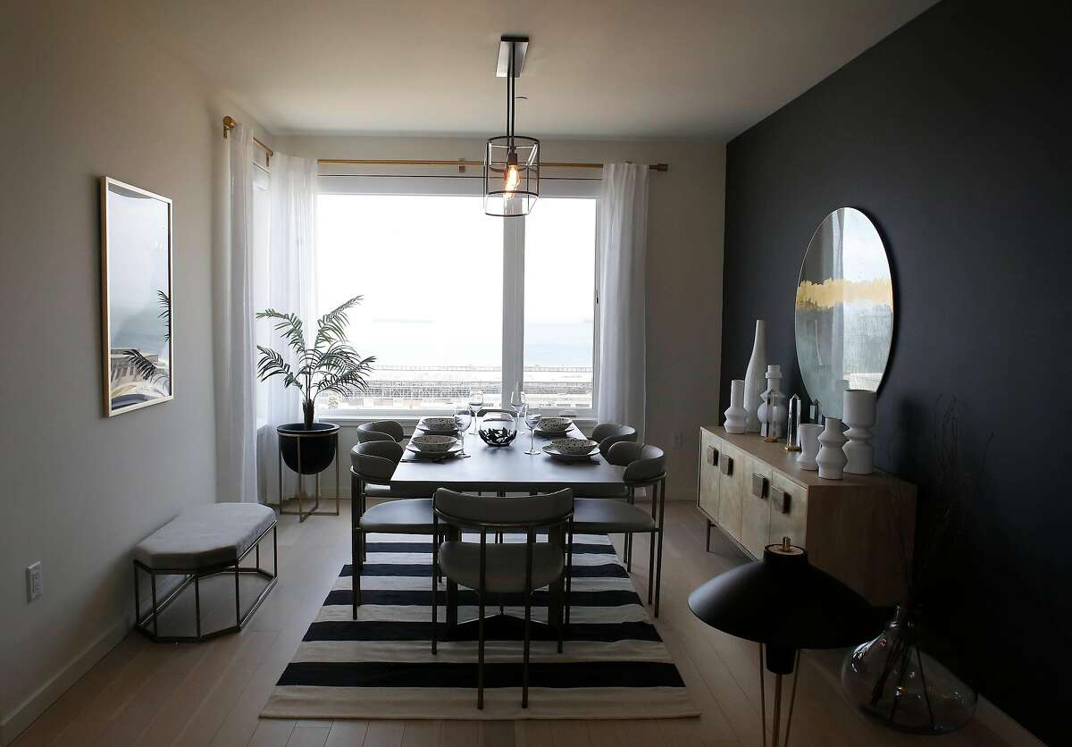 A dining area is seen in a model home in a newly constructed buiding on Parcel A.