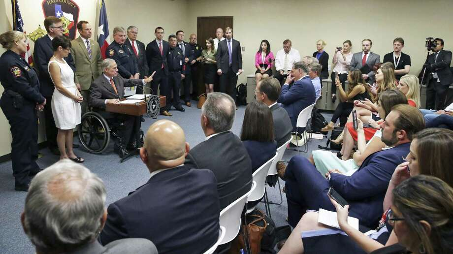 Gov. Greg Abbott reveals his school safety proposals at a press conference at the Hays County Law Enforcement Center in San Marcos on May 30, 2018. Photo: Tom Reel, Staff / San Antonio Express-News / 2017 SAN ANTONIO EXPRESS-NEWS