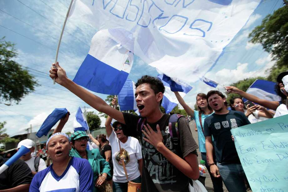 "Anti-government demonstrators shout slogans in Managua, Nicaragua on May 16, 2018 while Nicaraguan President Daniel Ortega attends the so-called ""national dialogue"" talks with Nicaragua's Roman Catholic bishops and the opposition in a bid to quell a month of anti-government unrest that has seen more than 50 people killed. Photo: DIANA ULLOA / AFP /Getty Images / AFP or licensors"