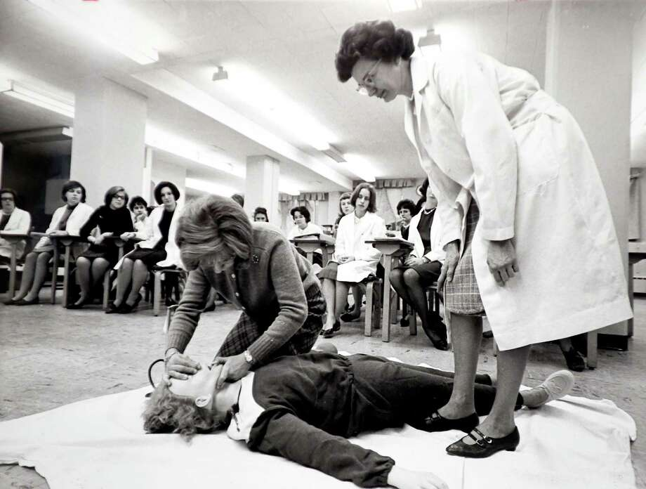 A nursing student uses a life-sized mannequin to demonstrate a resuscitation technique in 1965.  Photograph provided courtesy of the Yale-New Haven Hospital Archive Photo: Arnold Gold / Hearst Connecticut Media / New Haven Register