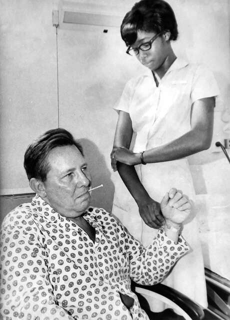 Nurse's aid Patricia Fields takes the temperature and pulse of David Fitzgerald of Milford at the Hospital of St. Raphael in October of 1966.  Photograph provided courtesy of the Yale-New Haven Hospital Archive Photo: Arnold Gold / Hearst Connecticut Media / New Haven Register