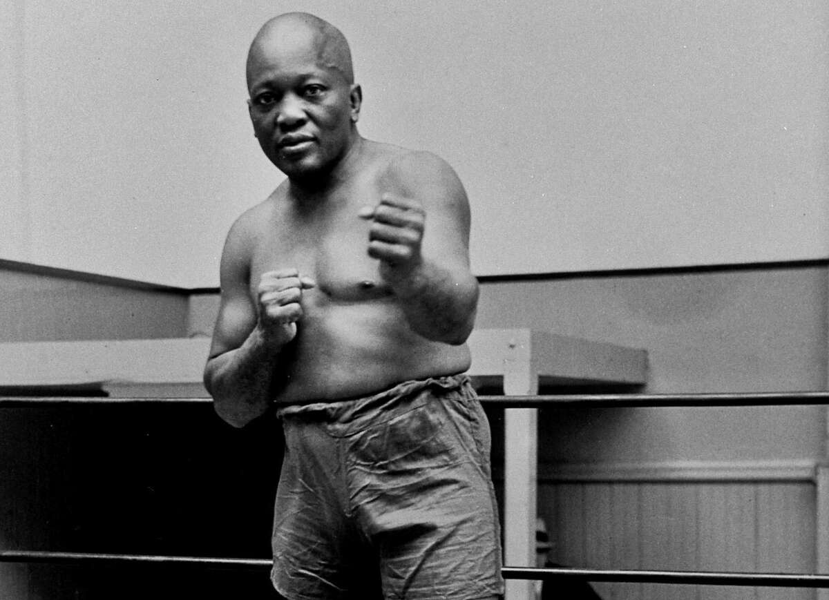 The rare posthumous pardon was granted to boxing's first black heavyweight champion, Jack Johnson, more than 100 years after a racially charged conviction.