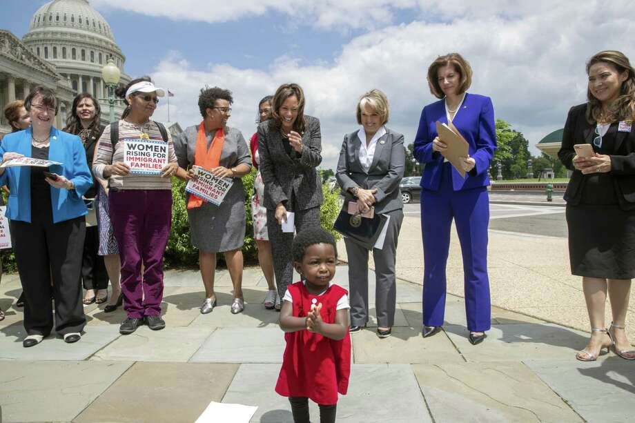 Hawa Tembe, whose mother is from Mozambique, joins the applause as Sen. Kamala Harris, D-Calif., top center, joined by Hispanic Caucus Chair Rep. Michelle Lujan Grisham, D-N.M., and Sen. Catherine Cortez Masto, D-Nev., protest threats by President Donald Trump to separate Central American asylum-seekers from their children along the southwest border to deter migrants from crossing into the United States. Photo: J. Scott Applewhite /Associated Press / Copyright 2018 The Associated Press. All rights reserved.