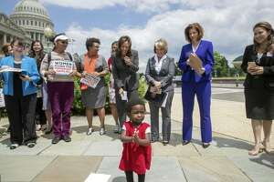 Hawa Tembe, whose mother is from Mozambique, joins the applause as Sen. Kamala Harris, D-Calif., top center, joined by Hispanic Caucus Chair Rep. Michelle Lujan Grisham, D-N.M., and Sen. Catherine Cortez Masto, D-Nev., protest threats by President Donald Trump to separate Central American asylum-seekers from their children along the southwest border to deter migrants from crossing into the United States.
