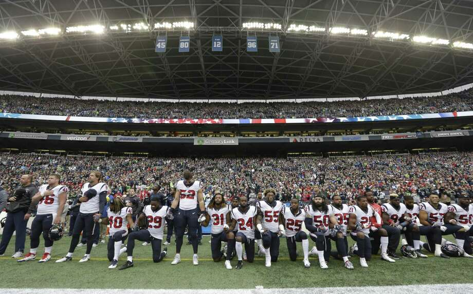 Houston Texans players kneel and stand on Oct. 29 during the singing of the national anthem before an NFL football game against the Seattle Seahawks, in Seattle. A reader disagrees with a columnist on this, and defends him. Photo: Elaine Thompson /Associated Press / Copyright 2017 The Associated Press. All rights reserved.