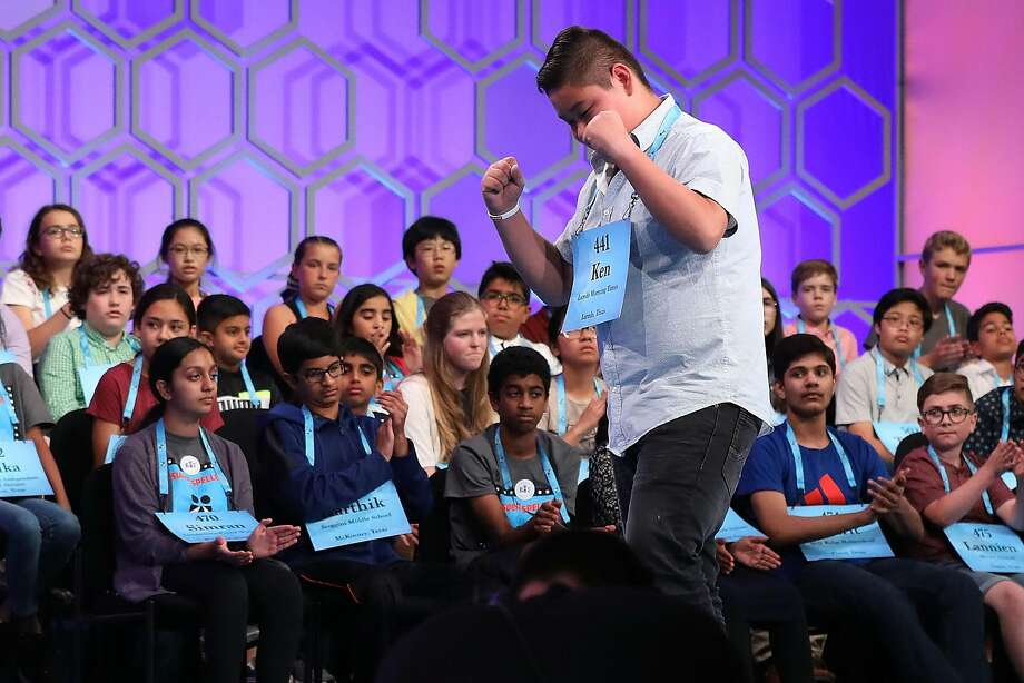 NATIONAL HARBOR, MD - MAY 30:  Ken Yaguchi, 14, of Laredo, Texas, pumps his fists after spelling a word correctly during the third round of the 91st Scripps National Spelling Bee at the Gaylord National Resort and Convention Center May 30, 2018 in National Harbor, Maryland. 516 spellers from across the country and around the world competed in the bee.  (Photo by Chip Somodevilla/Getty Images) Photo: Chip Somodevilla, Getty Images