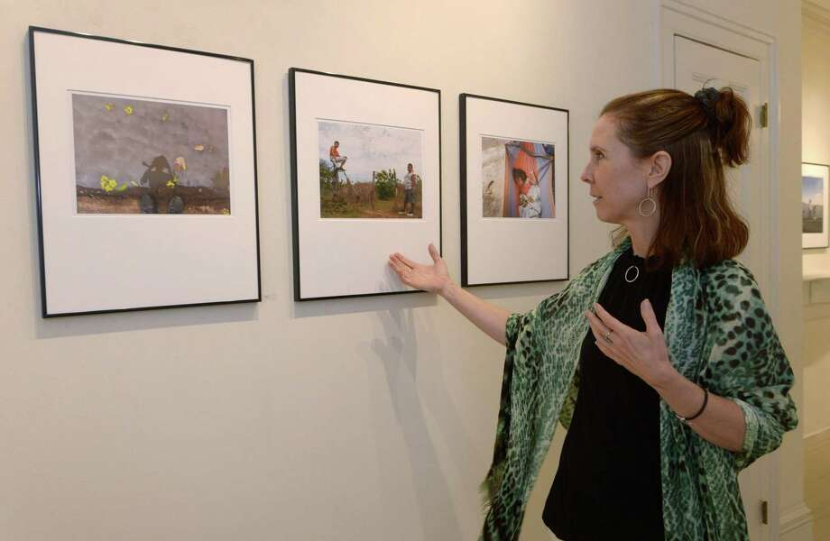 Director of NicaPhoto, Ronnie Mahr, describes the student photography behind the show, Look: NicaPhoto - Portraits of Nicaragua, at the 22 Haviland Gallery Wednesday, May 30, 2018, in Norwalk, Conn. NicaPhoto runs a educational program in Nagarote, Nicaragua, that benefits children in Norwalk's sister city. Photo: Erik Trautmann / Hearst Connecticut Media / Norwalk Hour