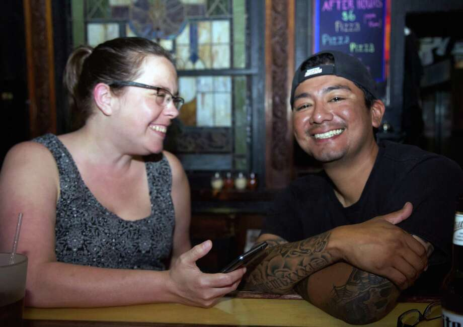 Melinda Leslies and Eric Amador have a good time at Rookies Too. Photo: Xelina Flores /For The Express-News