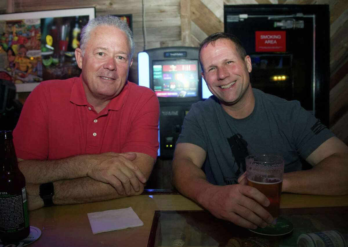 Tom Yeager and Scott Young have drinks at Rookies Too.