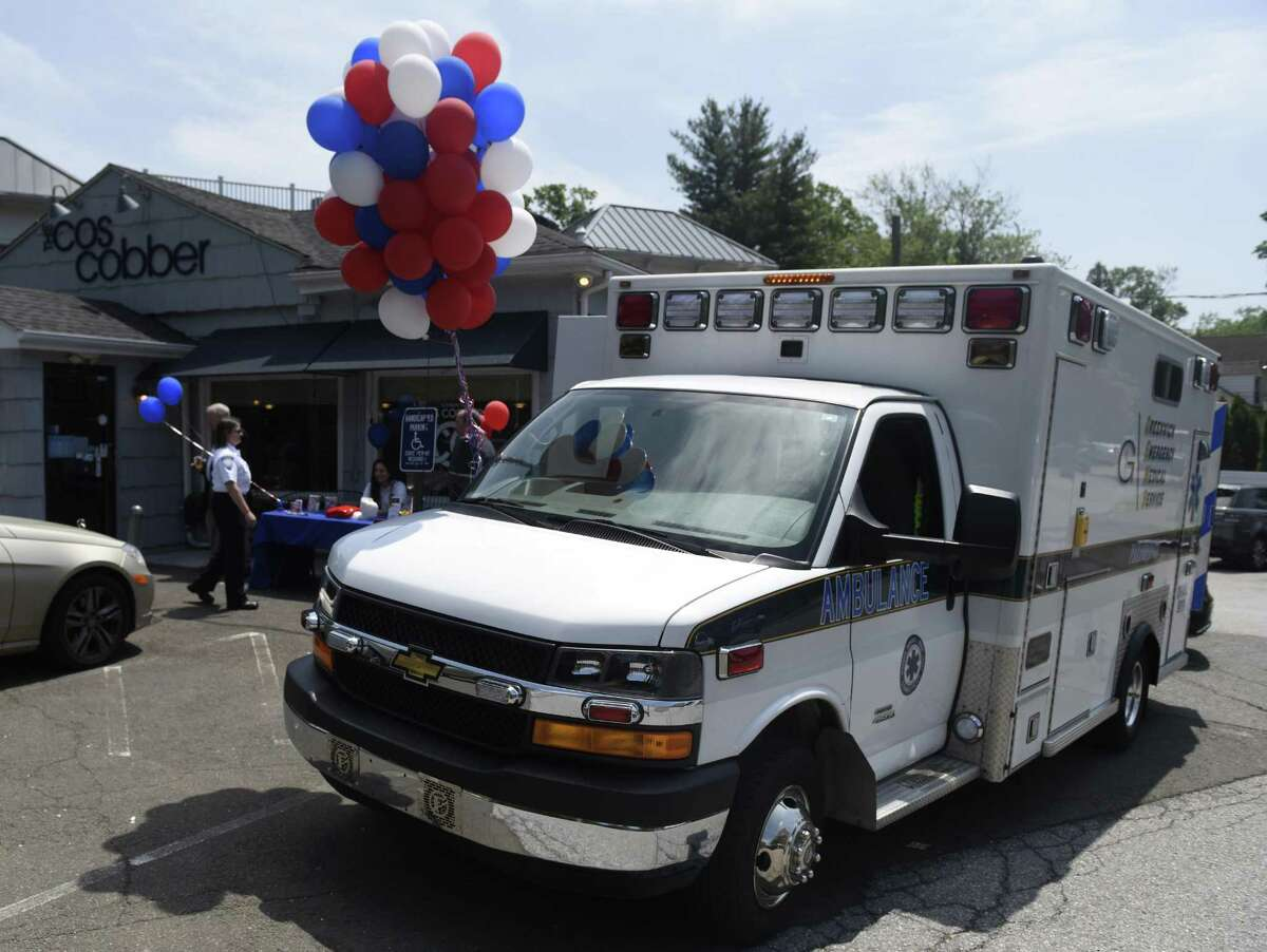A Greenwich Emergency Medical Service (GEMS) ambulance is parked at a fundraiser in the Cos Cob section of Greenwich, Conn. Wednesday, May 30, 2018.