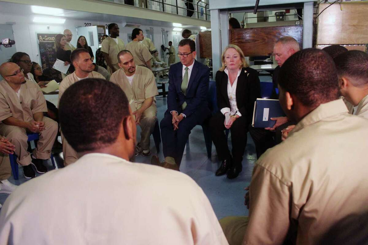 Connecticut Gov. Dannel P. Malloy, first lady Cathy Malloy and Correction Department Commissioner Scott Semple speak with inmates inside the Cheshire Correctional Institution in Cheshire, Conn. on Wednesday May 30, 2018. The inmates are part a program designed to support the needs of 18 to 25 year old offenders, whose brains are still developing.