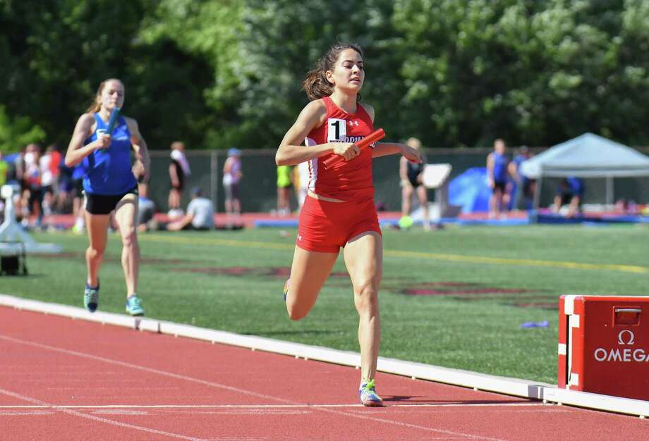 Greenwich's Emily Philippides crosses the finish line as anchor on the winning 4x800 relay team at the Class LL state championship meet on Wednesday. Photo: Gregory Vasil / For Hearst Connecticut Media / Connecticut Post Freelance