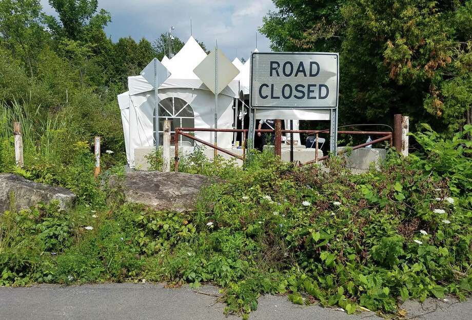 The end of Roxham Road in Champlain, N.Y., near Plattsburgh. The Canadian government has set up tents to process a flood of migrants crossing the border at the illegal crossing. (Chris Churchill / Times Union)