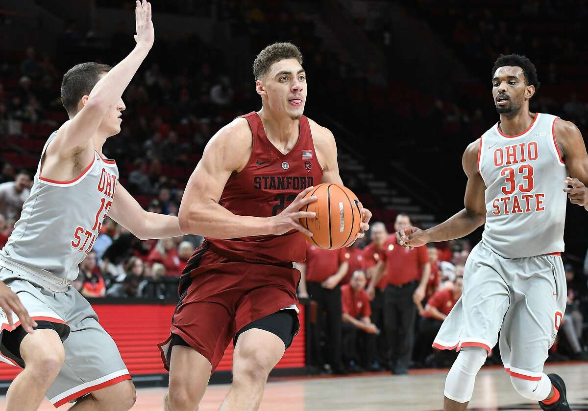 PORTLAND, OR - NOVEMBER 24: Stanford University forward Reid Travis (22) looks to pass against Ohio State University guard Andrew Dakich (13) and Ohio State University forward Keita Bates-Diop (33) in a college basketball game during the PK80-Phil Knight Invitational between the Stanford Cardinal and Ohio State Buckeyes on November 24, 2017, at Moda Center in Portland, OR. (Photo by Brian Murphy/Icon Sportswire via Getty Images)