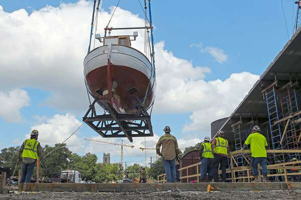 Workers with TNT Crane & Rigging move a 14-ton Danish rescue boat into what will be its future home inside the expansion of the Holocaust Museum Houston, Wednesday, May 30, 2018, in Houston. Both the boat, which is the type of boat that was used to ferry thousands of Danish Jews to safety in Sweden over a three-week period in 1943, and a World War II era rail car were relocated when renovations began and now will be viewed end to end inside the museum when it reopens in the Spring of 2019. ( Mark Mulligan / Houston Chronicle )