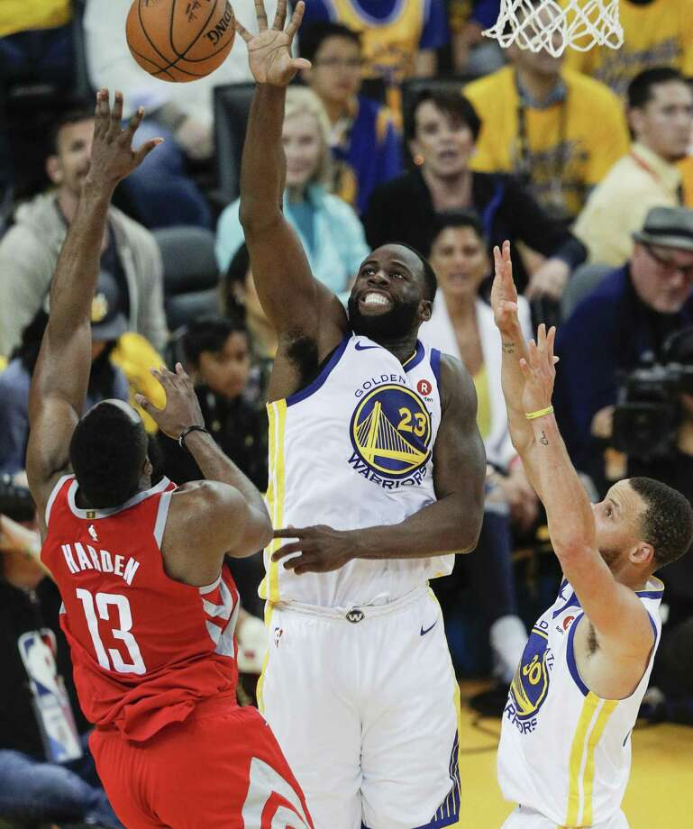Golden State Warriors' Draymond Green blocks a Houston Rockets' James Harden shot in the third quarter during game 6 of the Western Conference Finals between the Golden State Warriors and the Houston Rockets at Oracle Arena on Saturday, May 26, 2018 in Oakland, Calif. Photo: Carlos Avila Gonzalez / The Chronicle / online_yes